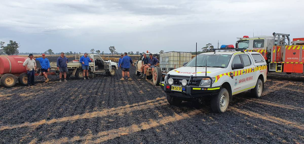 Farmers and RFS volunteers gathered to quickly contain this fire that broke out during harvest. Photo supplied.