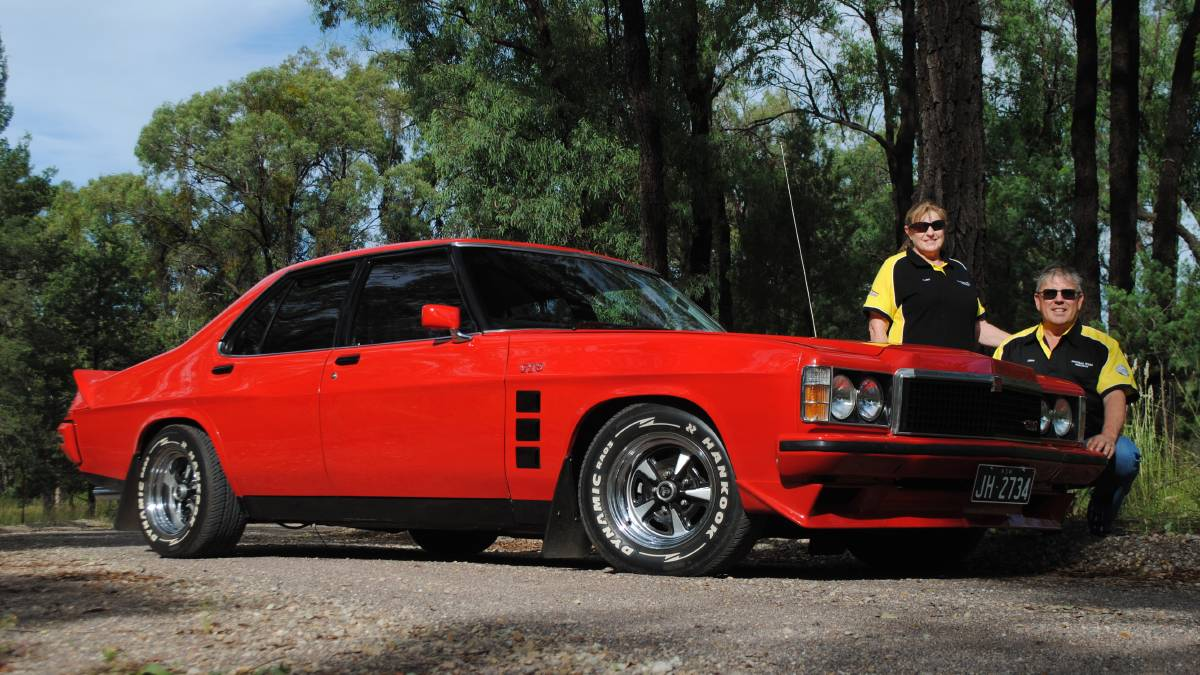 John and Jacki Hutty from Dubbo with one of their Sandmans, a 1978 Flamenco Red HZ GTS.