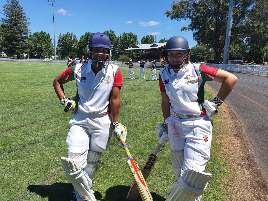 ALL SMILES: Marites Woods (left) and Maddy Spence (right) getting ready to bat for Western in the CHS State Championships at Bathurst last week. It was Woods' last tournament for Western. Photo: Kerry Spence.