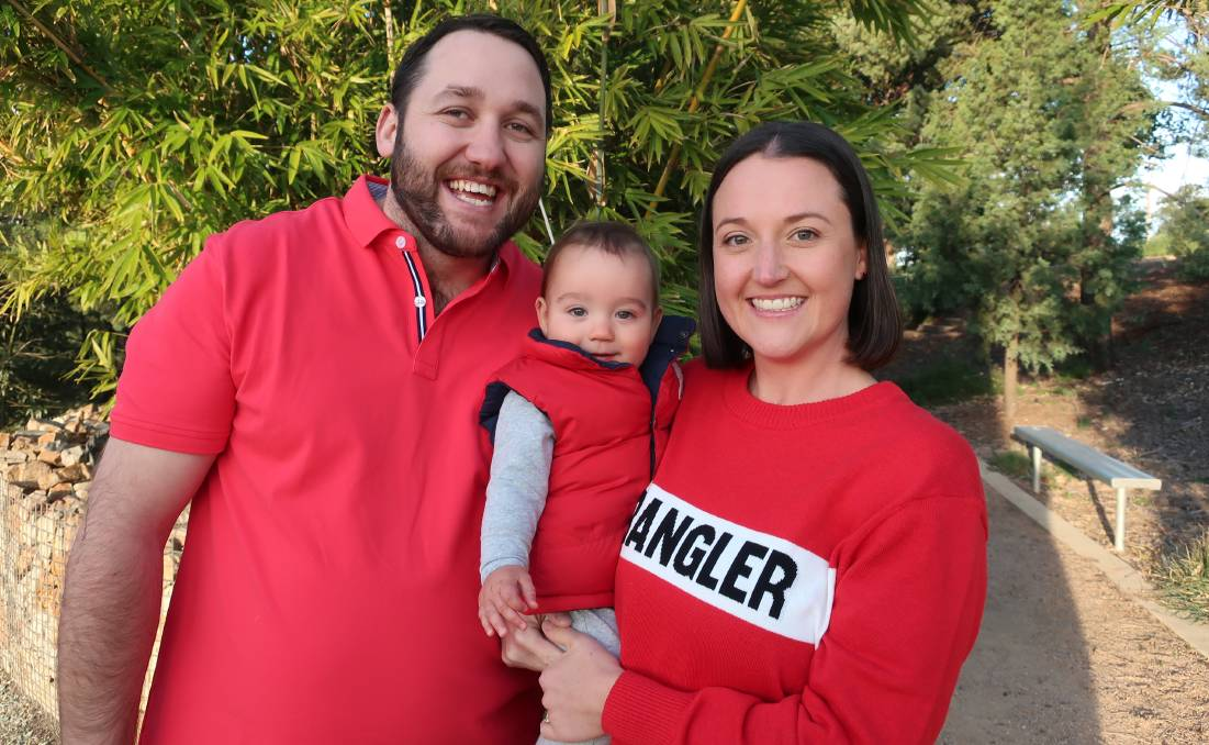 WEAR RED: Pat and Natalie Williams, with 10-month-old son Harvey, say Ronald McDonald House Orange allowed them to have vital bonding time when their son was born. Photo: SUPPLIED