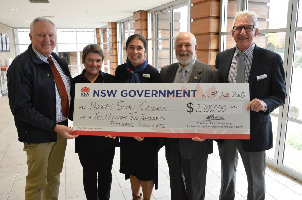 BIG BOOST: Parliamentary Secretary for Western NSW Rick Colless hands over $2.2 million to Cr Barbara Newton, Parkes library manager Shellie Buckle, Mayor Ken Keith OAM and Cr Bill Jayet.